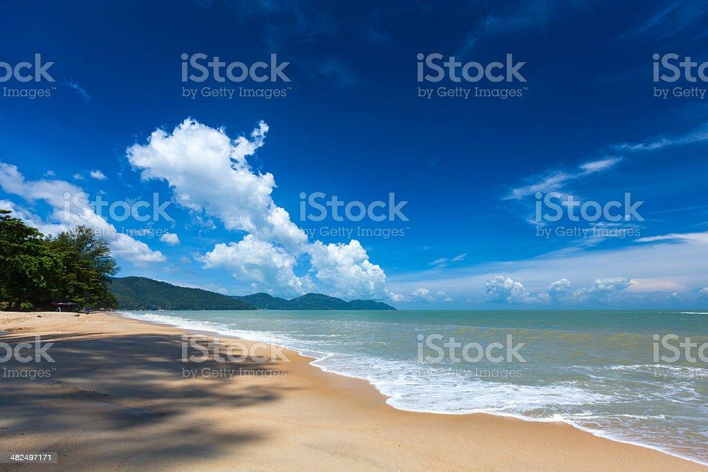 Sandy beach with blue sky stock photo