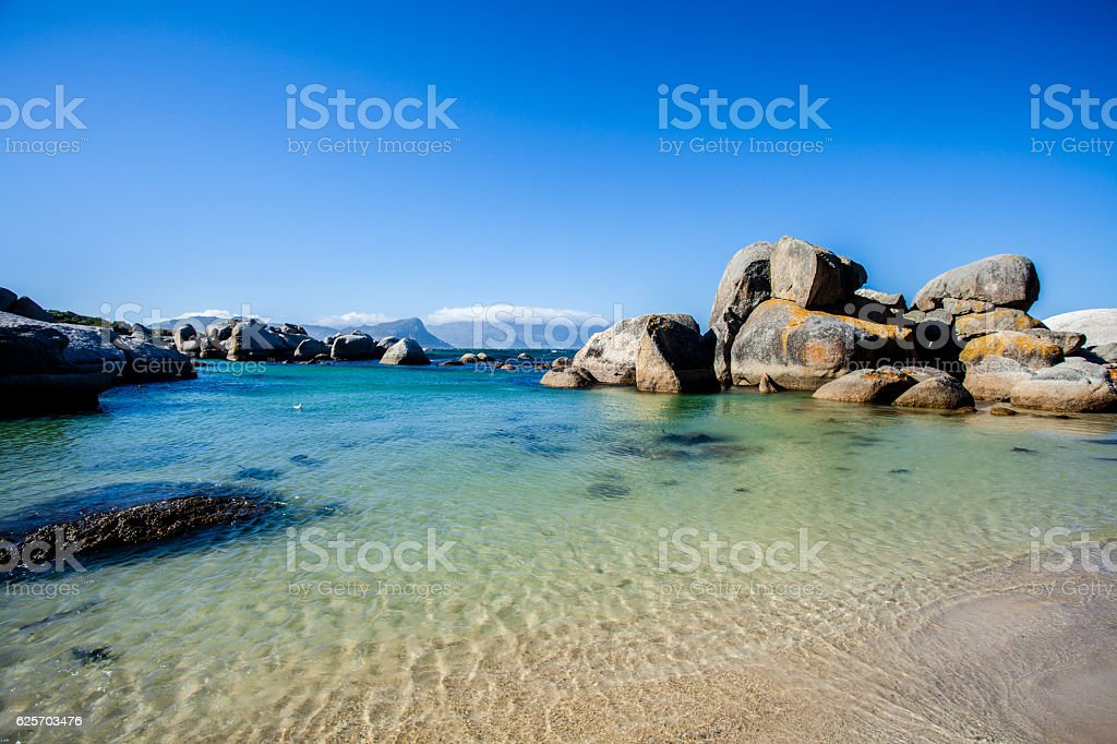 Sandy beach with boulders, Cape Town stock photo