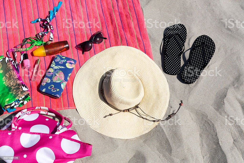 Sandy beach with summer accessories stock photo