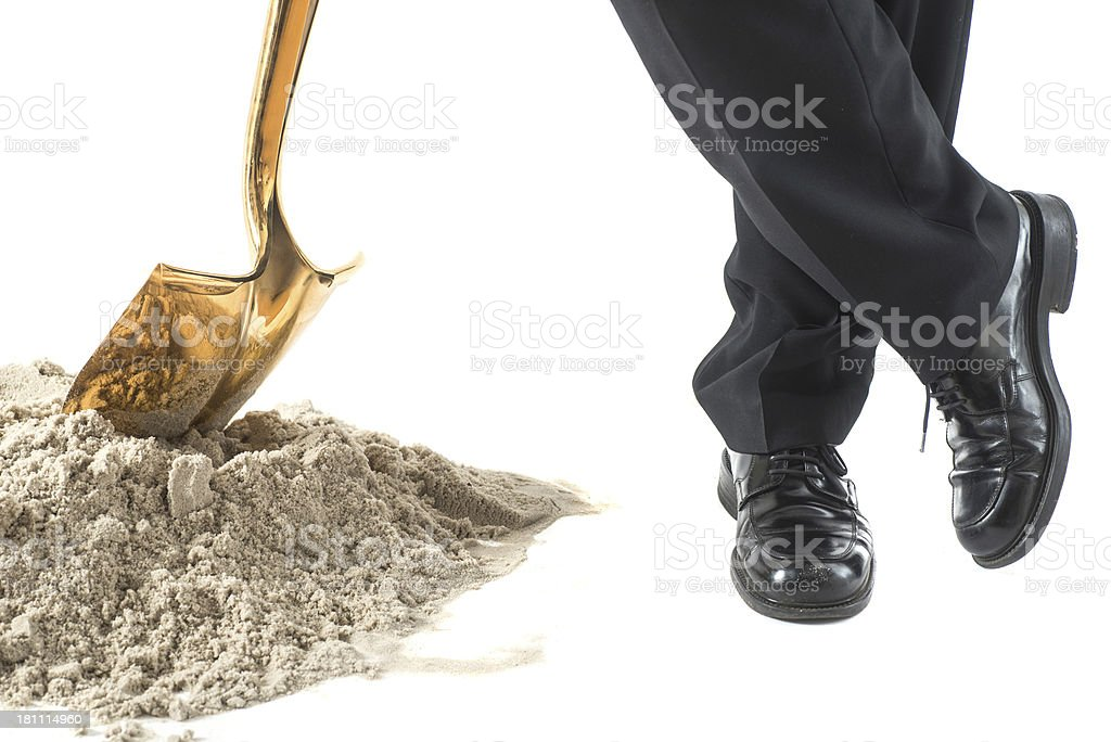 sandy golden shovel - Businessman stock photo
