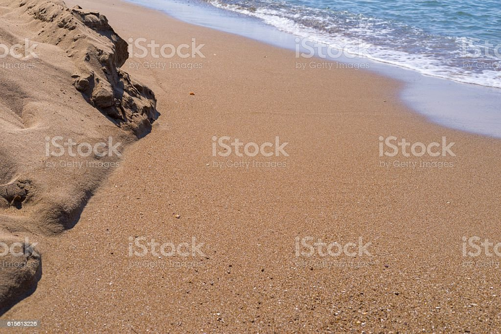 sandy heap ashore and water inflow closeup stock photo