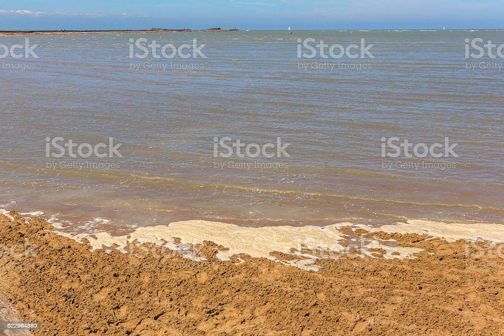 sandy normandy coast during tide near calais france stock photo