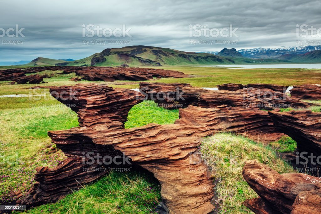 Sandy rocks with by magma formed by winds. stock photo