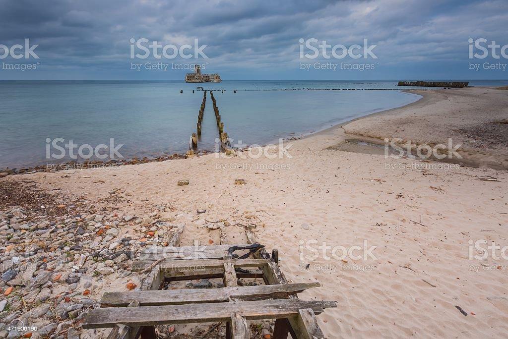 Sandy shore of Baltic sea and torpedownia near Gdynia. stock photo