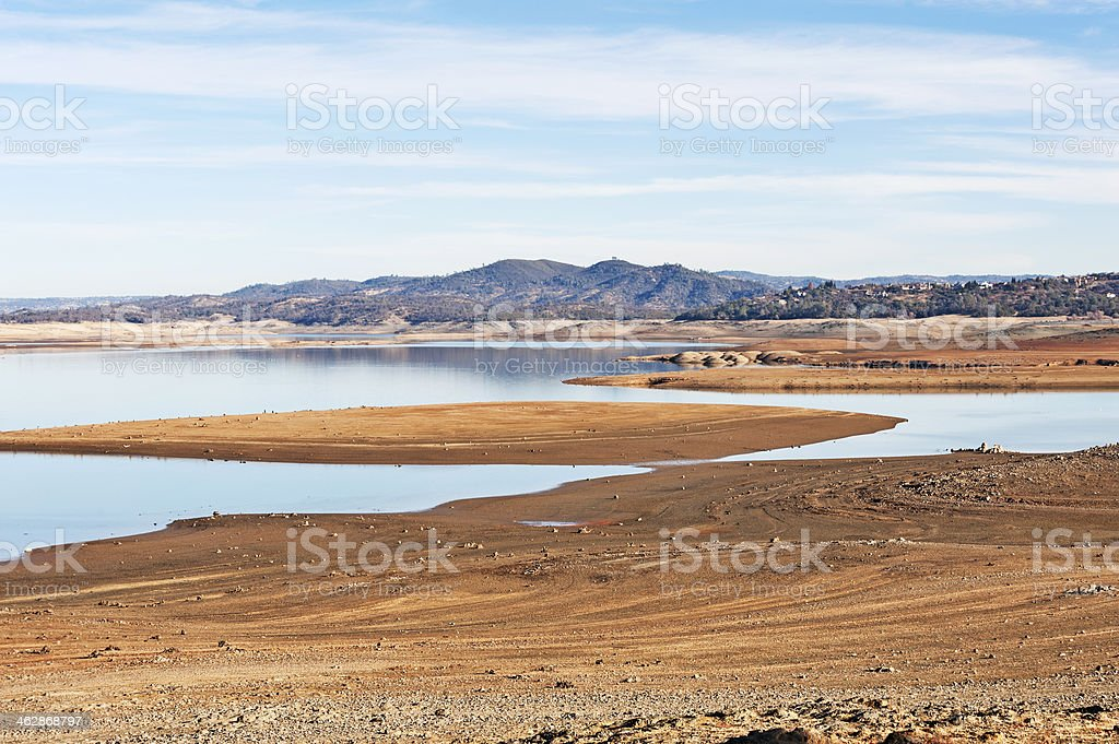Sandy shoreline view of lake with low water level stock photo