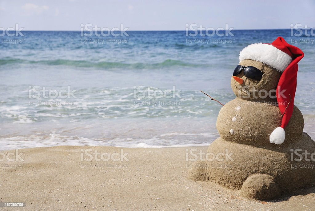 Sandy snowman in santa hat. Christmas holiday concept royalty-free stock photo