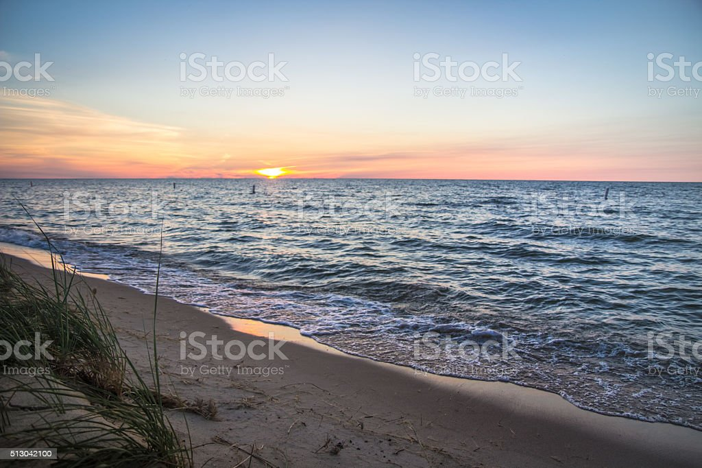 Sandy Summer Beach At Sunset stock photo