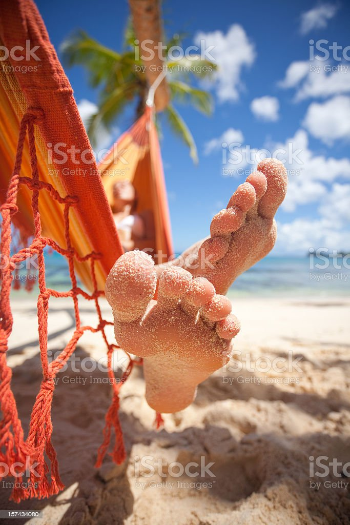 sandy toes of woman in hammock royalty-free stock photo