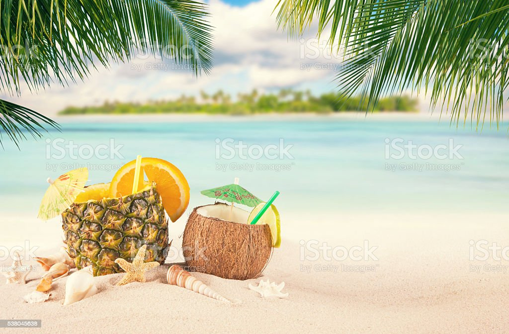 Sandy tropical beach with summer drinks stock photo