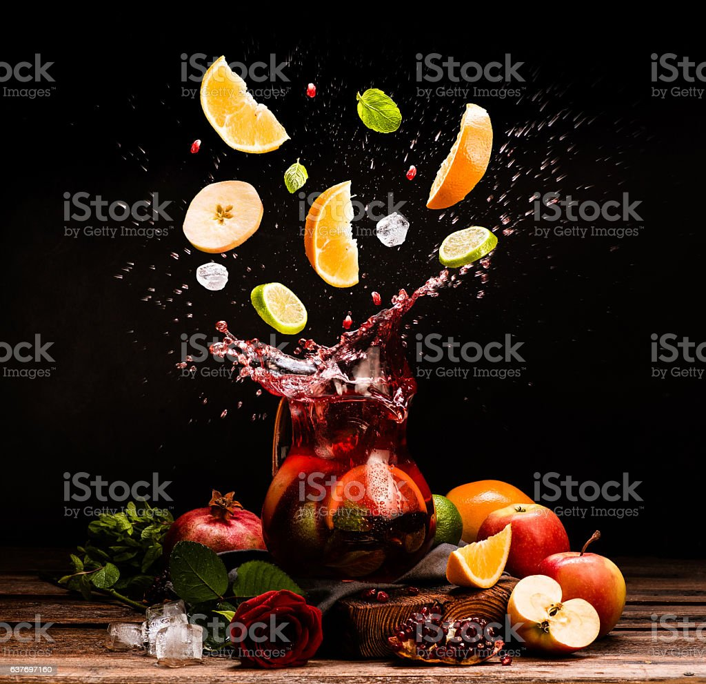 Sangria. Flying fruits. Apple, orange, lime, pomegranate, mint. Drink. Wine stock photo