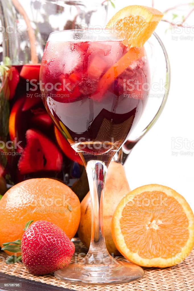 A sangria in a glass with oranges and a pitcher stock photo