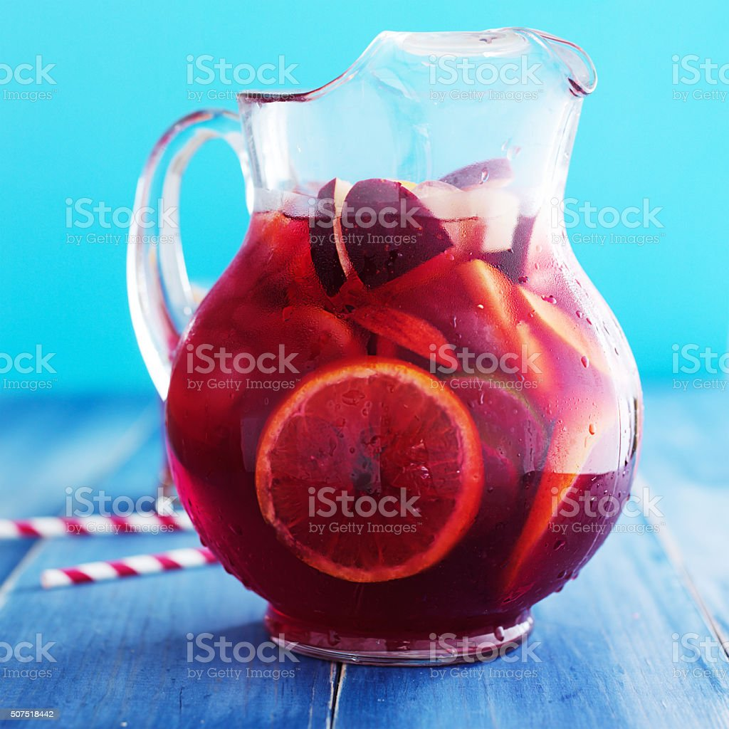 sangria pitcher with fruits on table top stock photo