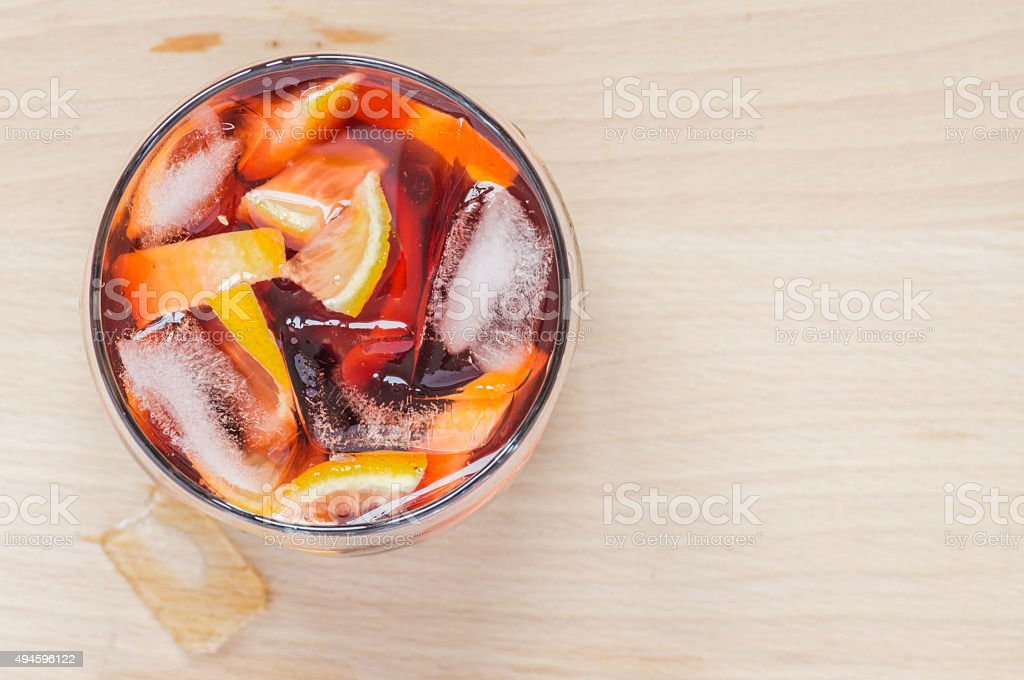 Sangria wine in the wineglass and pieces of ice stock photo