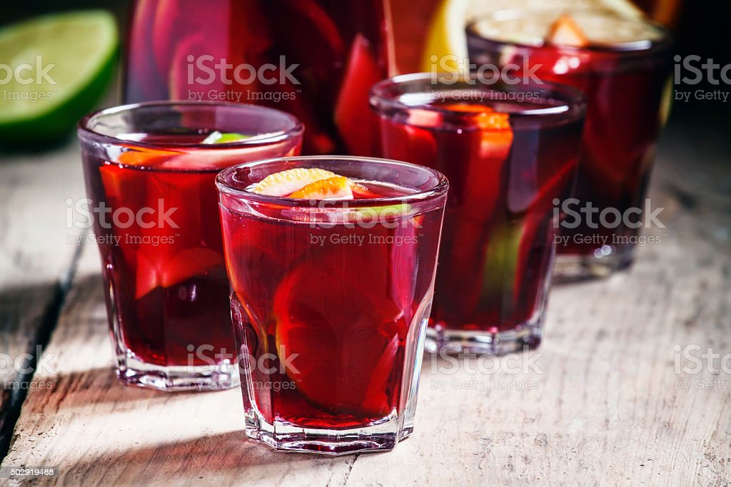 Sangria with fruit in a glass and a jug stock photo