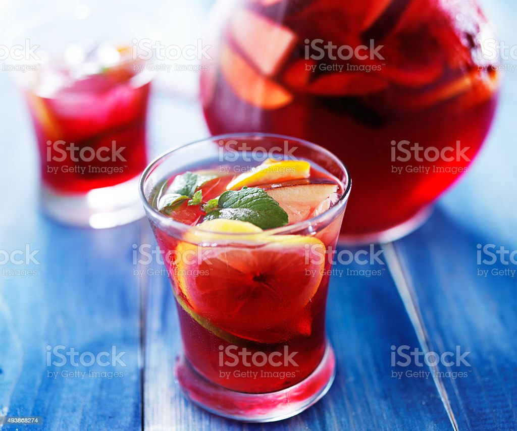 sangria with fruits and mint garnish in cup stock photo