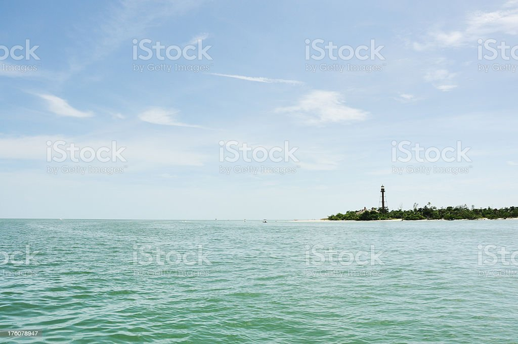 Sanibel Island Lighthouse and Boats on Gulf of Mexico stock photo