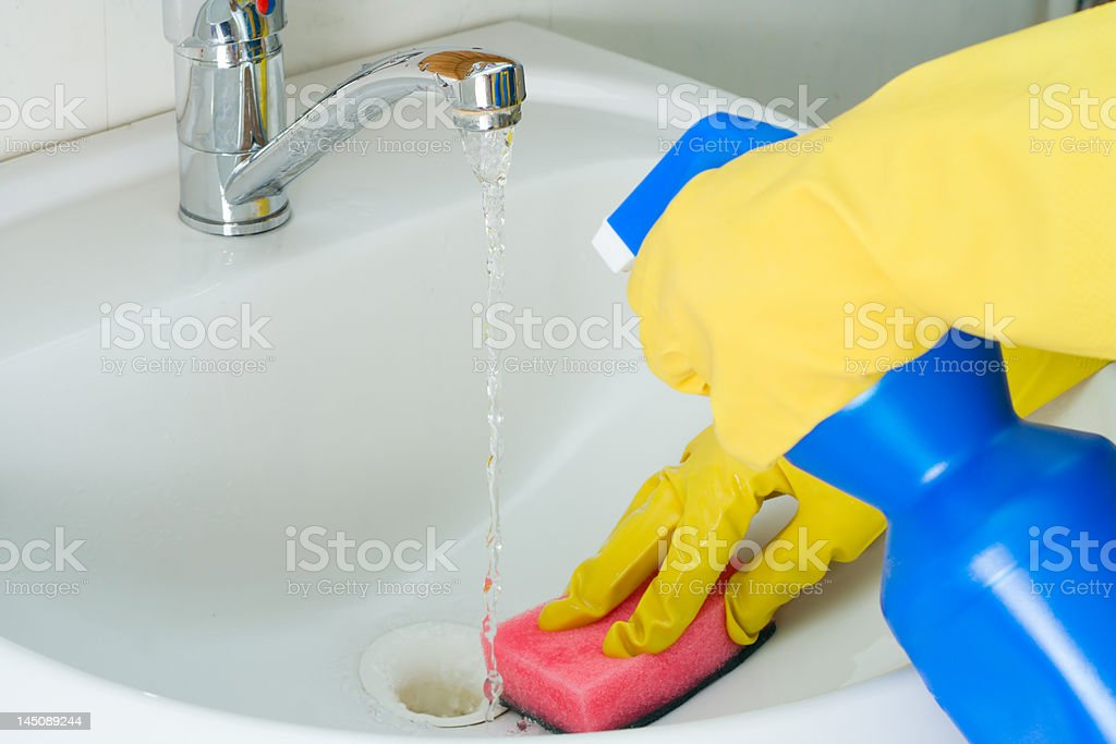 sanitary clearing of a sink stock photo