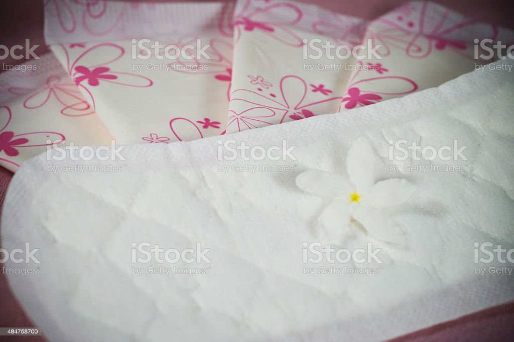 Sanitary pad package for woman hygiene protection stock photo