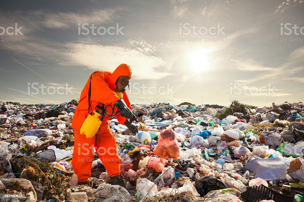 Sanitation worker working on the landfill stock photo