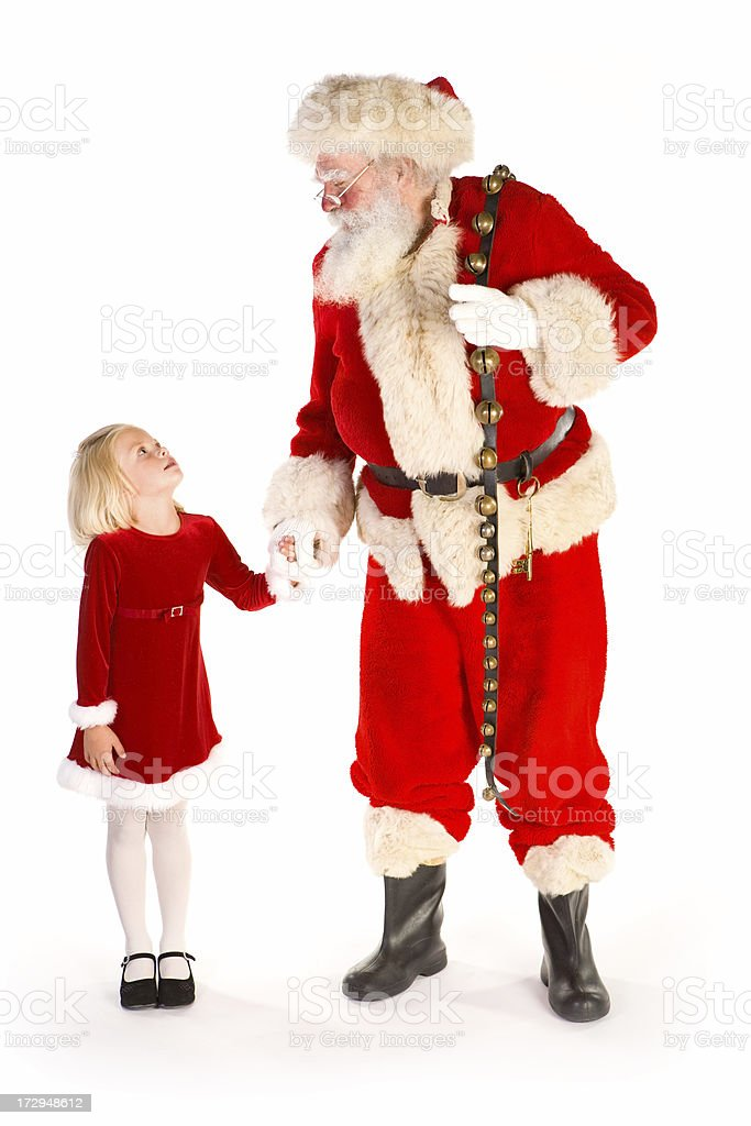 Santa and cute little girl holding hands royalty-free stock photo