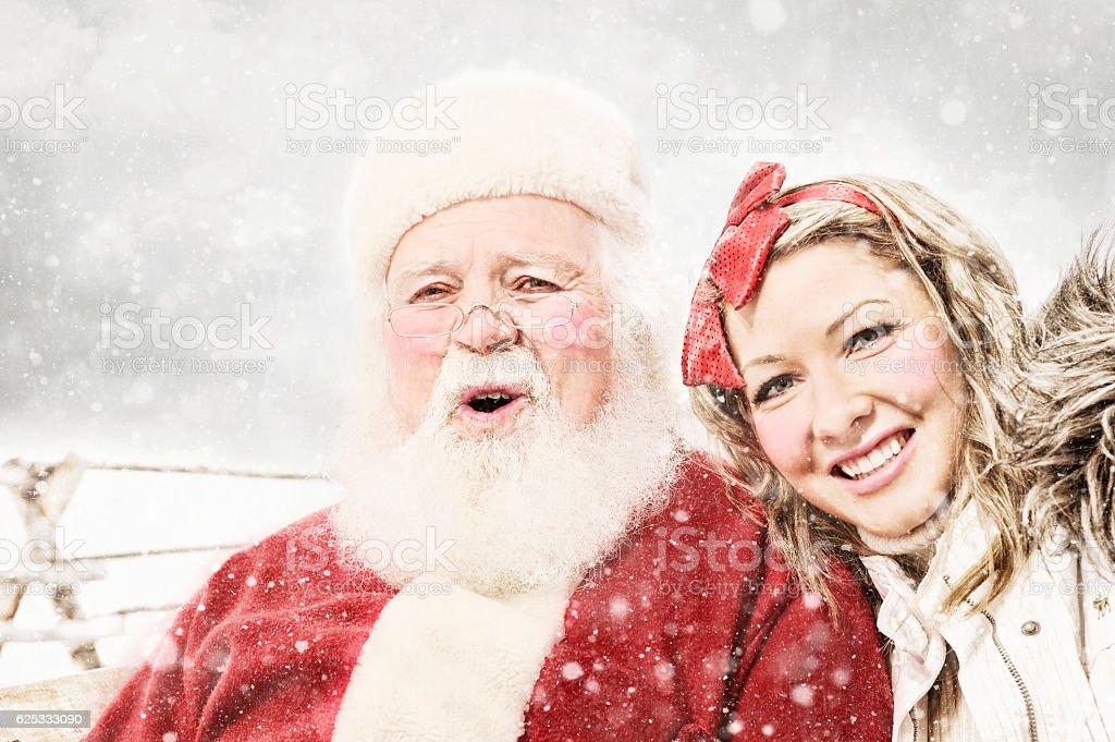 Santa and Elf In Rural Snow Storm stock photo