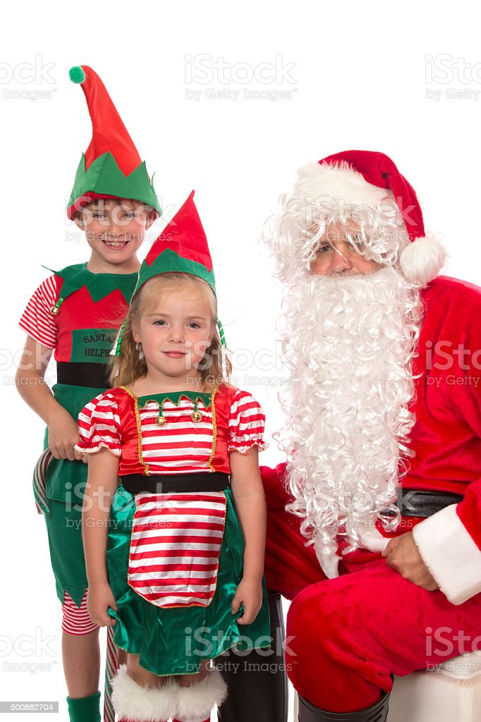 Santa And His Elves stock photo