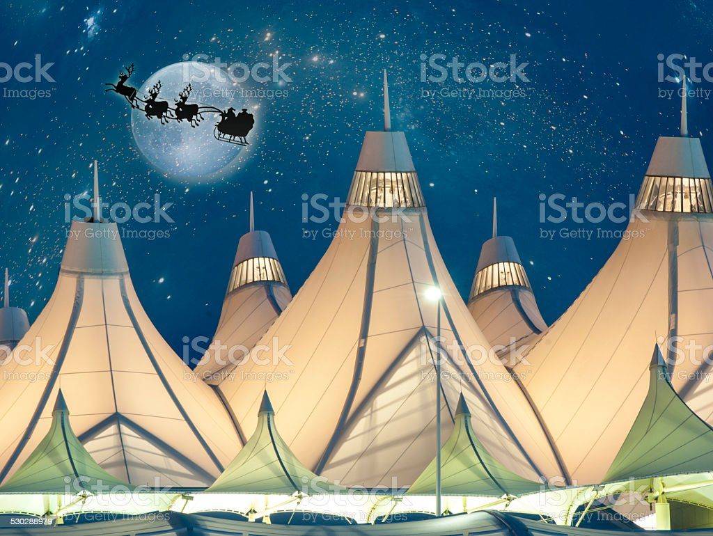 Santa and his Reindeers Flying Over Denver Airport stock photo