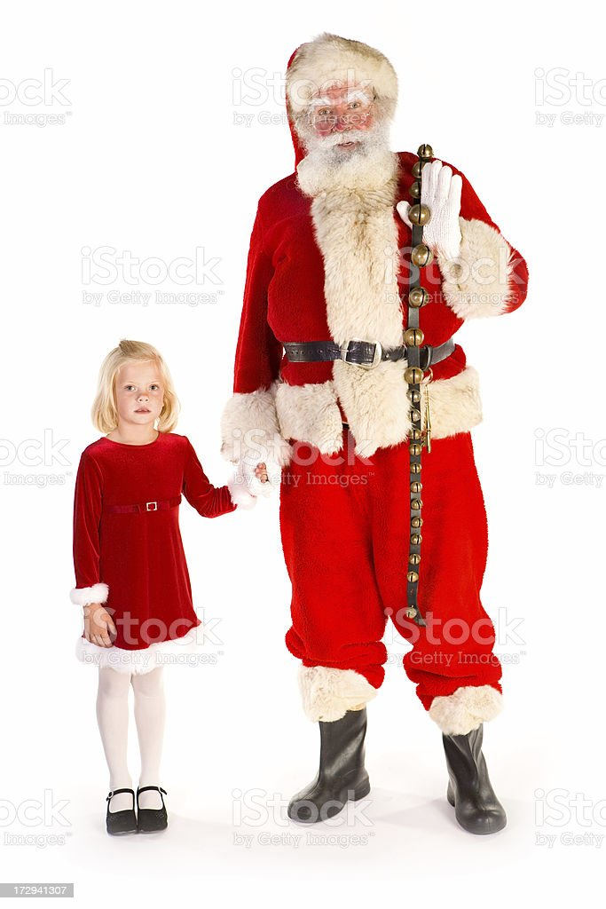 Santa and little girl holding hands look at camera royalty-free stock photo