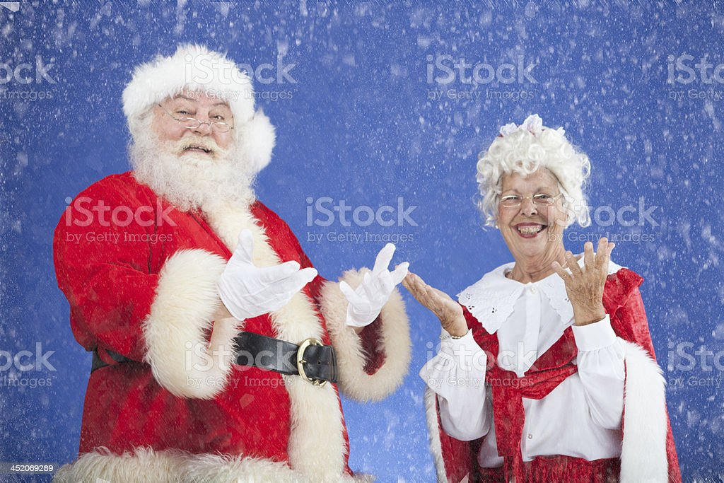 Santa and Mrs Claus catching snow stock photo