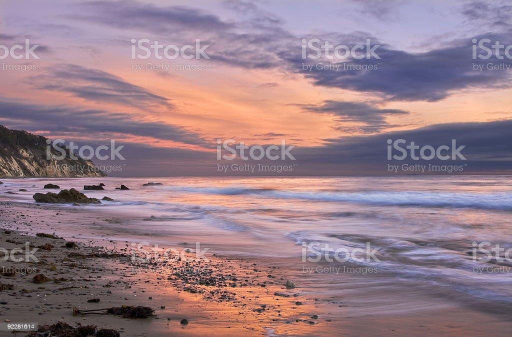 Santa Barbara foamy seashore at sunset stock photo