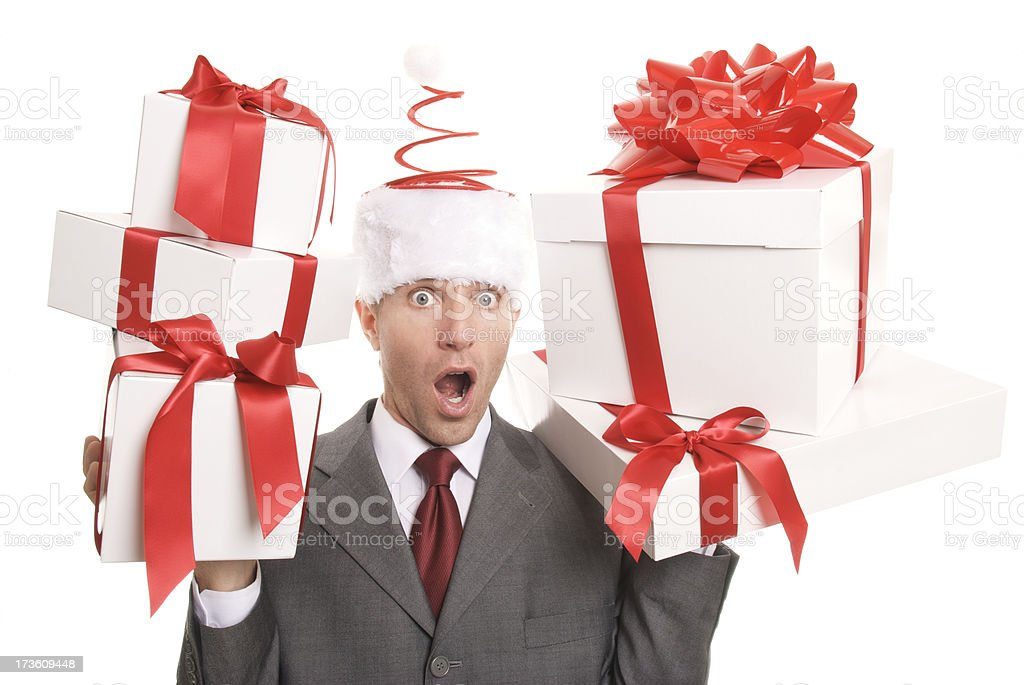 Santa Businessman Looks Surprised Holding Gifts royalty-free stock photo