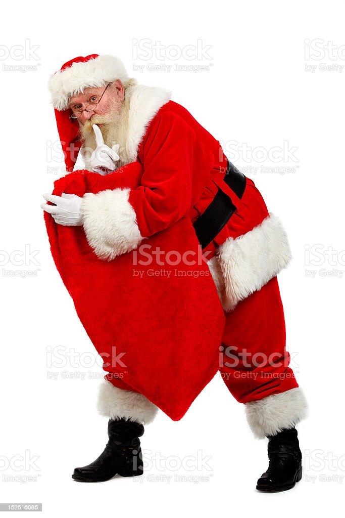 santa carying his sack stock photo