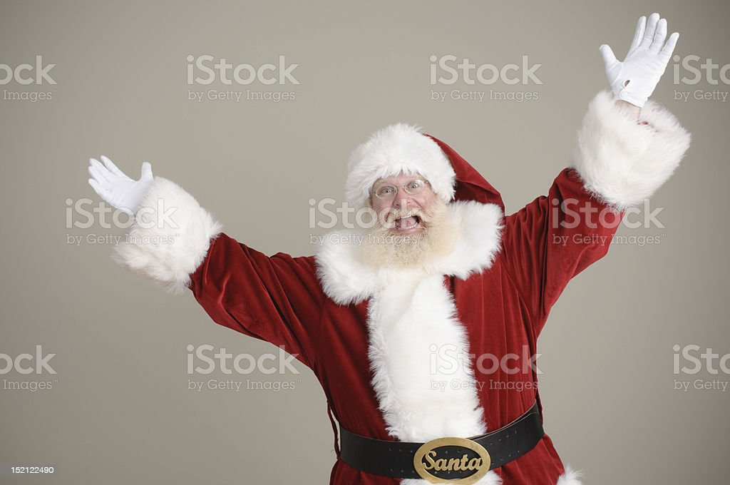 Santa celebrating with arms in the air royalty-free stock photo