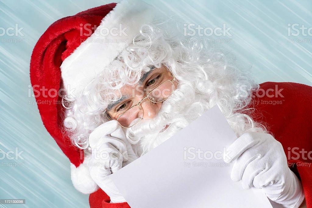 Santa checking his list royalty-free stock photo