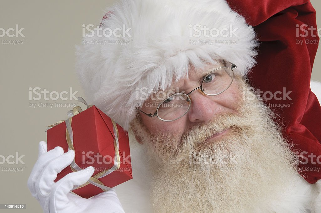 Santa checking out a red package royalty-free stock photo