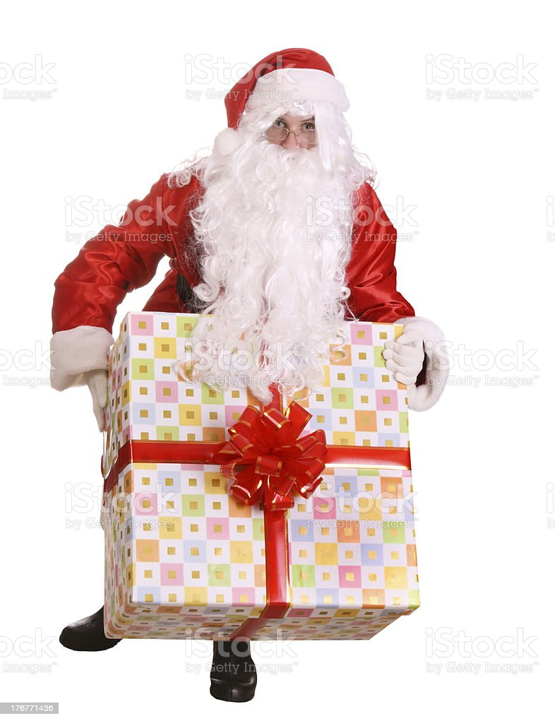 Santa Claus and big gift box with red bow. royalty-free stock photo