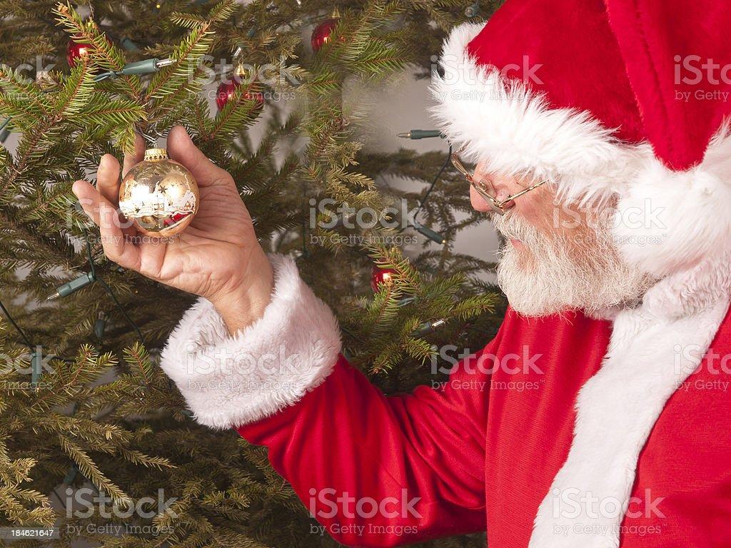 Santa Claus and christmas tree stock photo