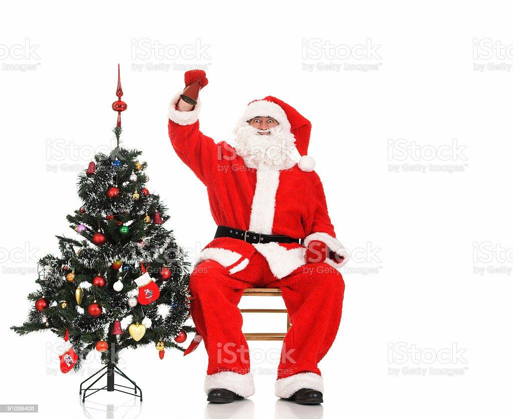 Santa Claus and Christmas tree royalty-free stock photo