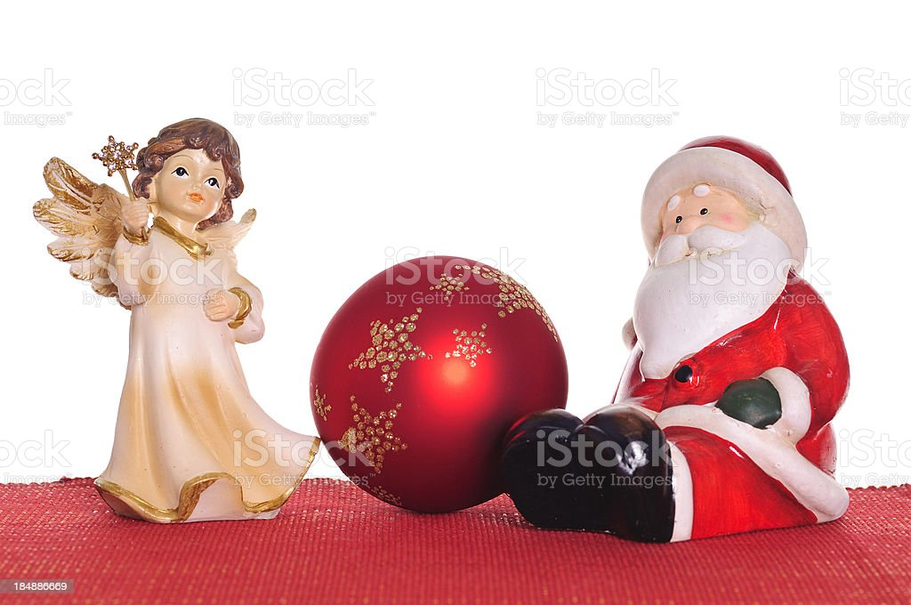 Santa Claus and european Christkind  on red textile with Ball royalty-free stock photo