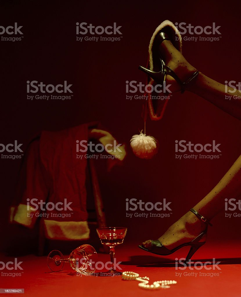 Santa Claus and his helper relax stock photo