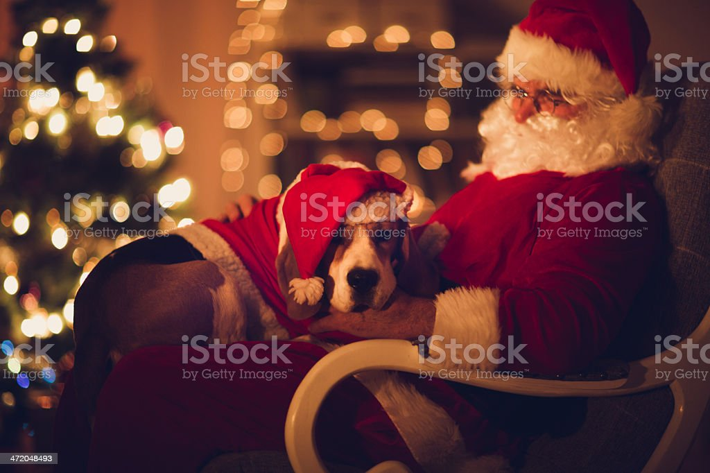 Santa Claus and his little helper stock photo