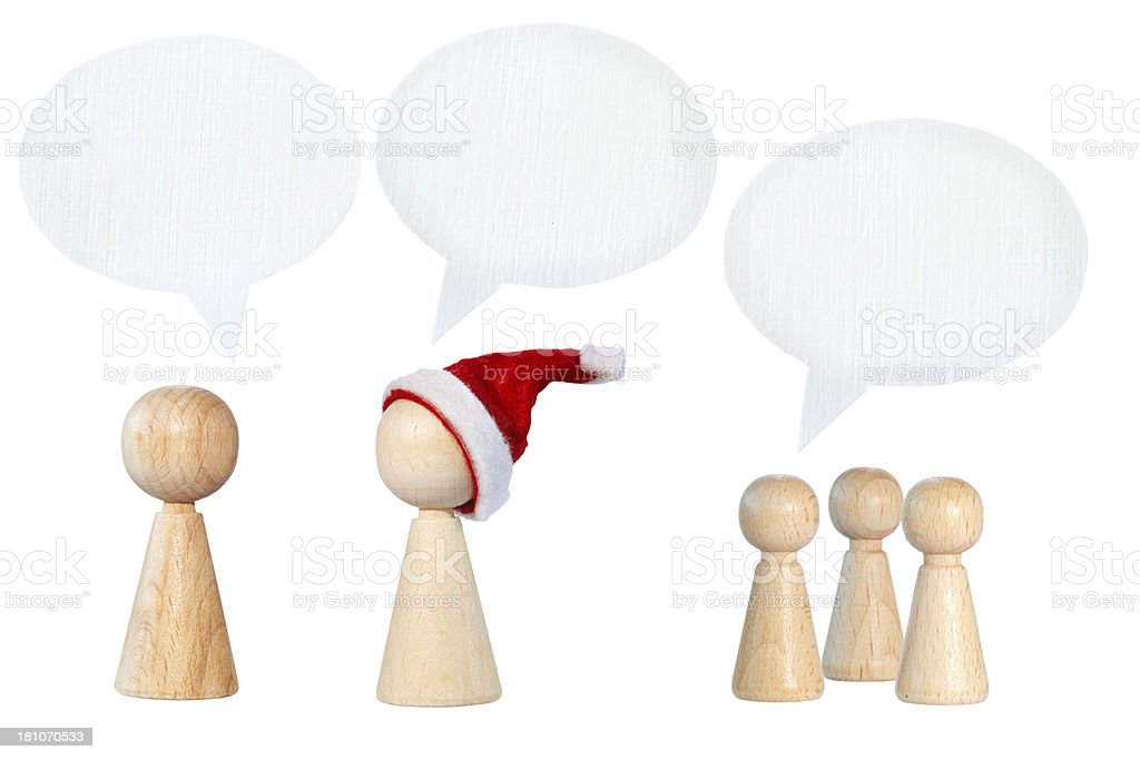 Santa Claus and other pawns with speech bubbles royalty-free stock photo