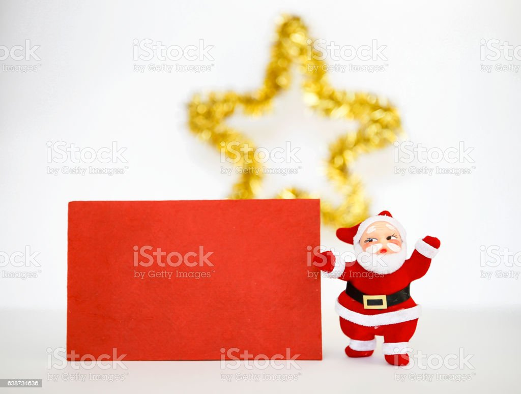Santa claus and red paper card stock photo