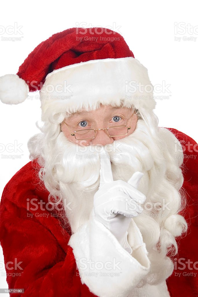 Santa Claus asking you to be quiet stock photo