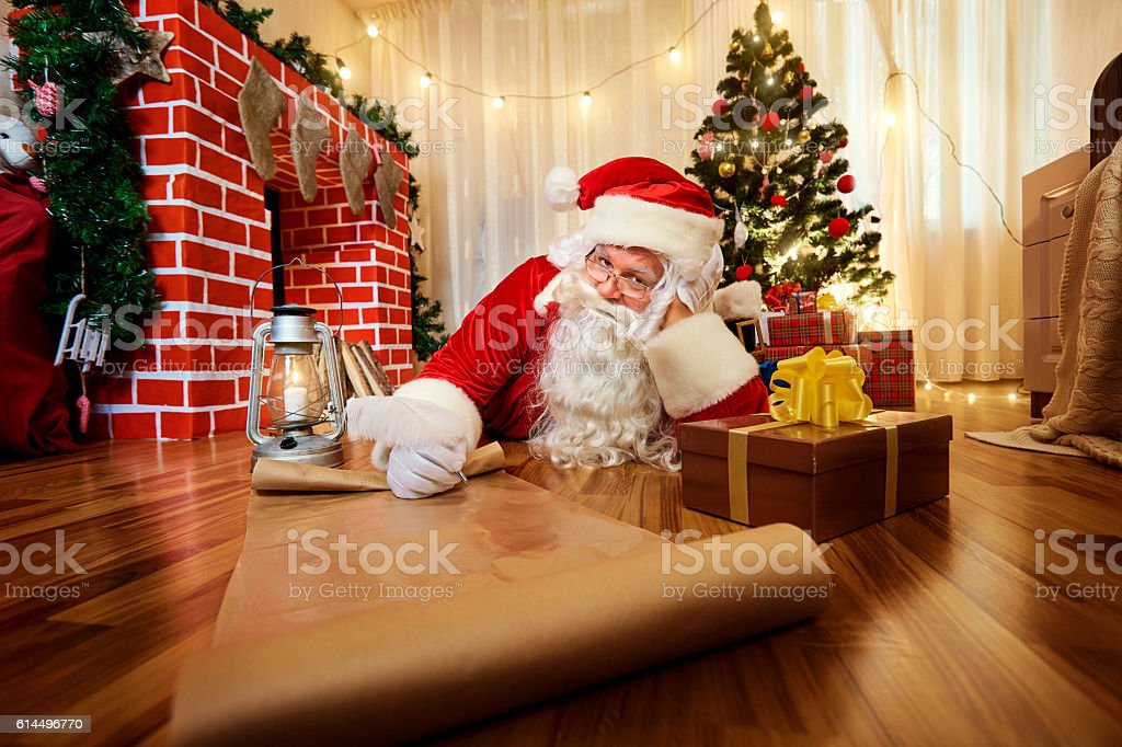 Santa Claus at Christmas, New Year's Eve wrote list  gifts stock photo