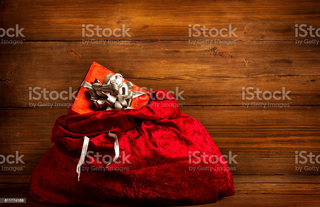 Santa Claus Bag, Present Gift Box, Christmas Sack Brown Wood stock photo