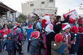 Santa Claus bringing candy to children in Greek refugee camp