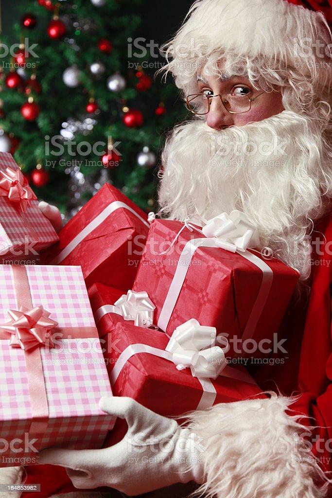 Santa Claus bringing gifts royalty-free stock photo