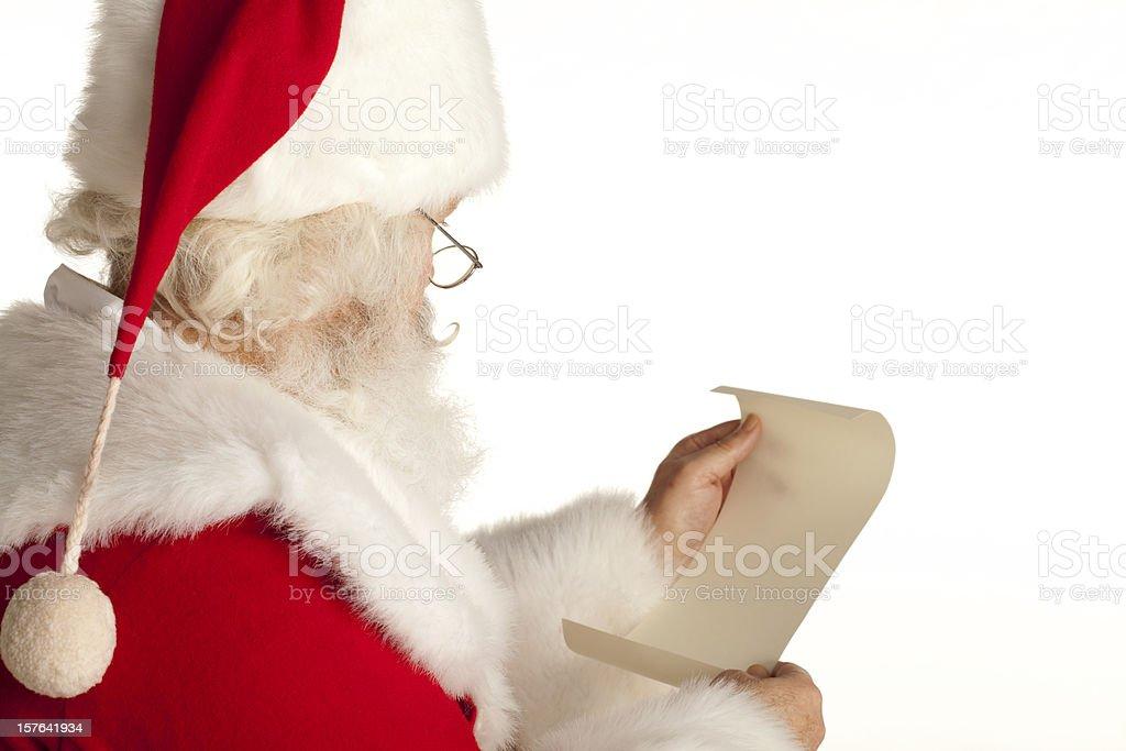 Santa Claus checking his list. White Background. XXXL stock photo