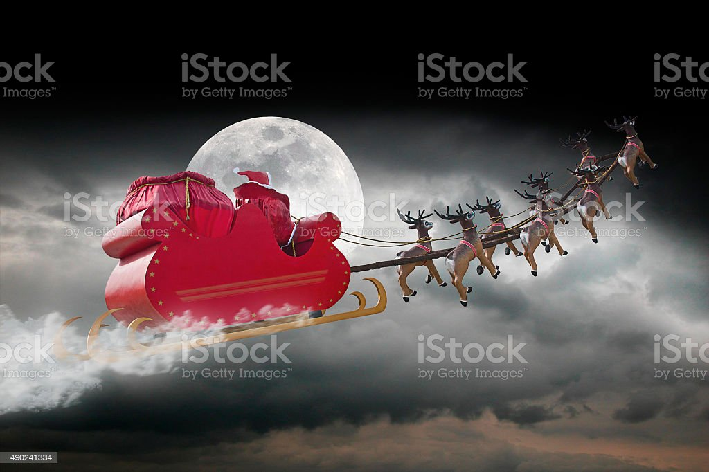 Santa Claus cloudy night stock photo
